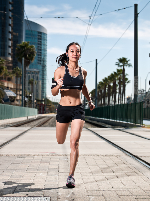 Fit woman running in town