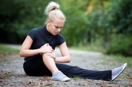 Girl holding knee from pain
