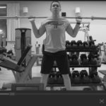 Man in Gym doing squats